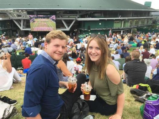 Meg and Jonny on Henman Hill at Wimbledon Championships with Pimms